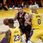 Cleveland Cavaliers' Kevin Love (0) is defended by Los Angeles Lakers Kyle Kuzma (0) during an NBA basketball game between Los Angeles Lakers and Cleveland Cavaliers, Monday, Jan. 13, 2020, in Los Angeles.
