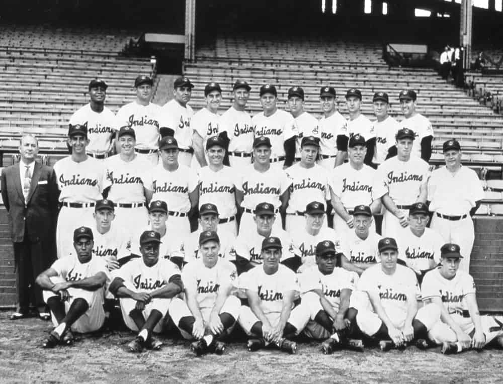 American League Champion Cleveland Indians pose for their team photograph in 1954. Larry Doby and Early Wynn are in the back row, far left and second from left, and Bob Lemon second from right. Bob Feller is in the middle row, second from left, and manager Al Lopez is in the second row from the bottom, center.