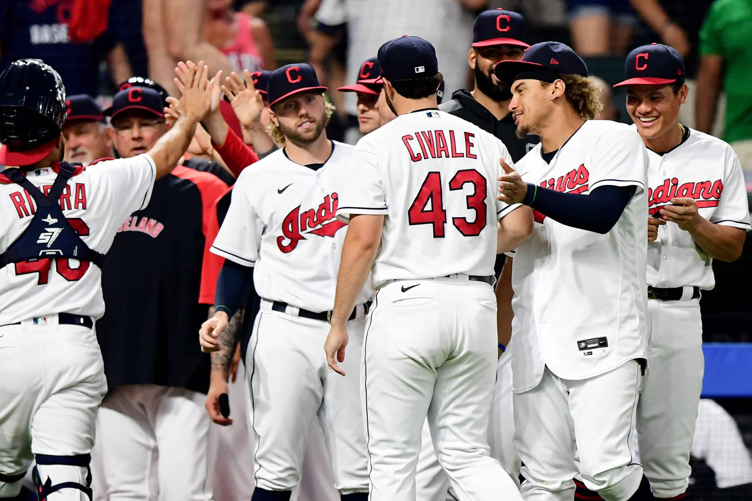 Members of the Cleveland Indians celebrate with Aaron Civale #43 after their 7-0 win over the Seattle Mariners during their game at Progressive Field on June 11, 2021 in Cleveland, Ohio.