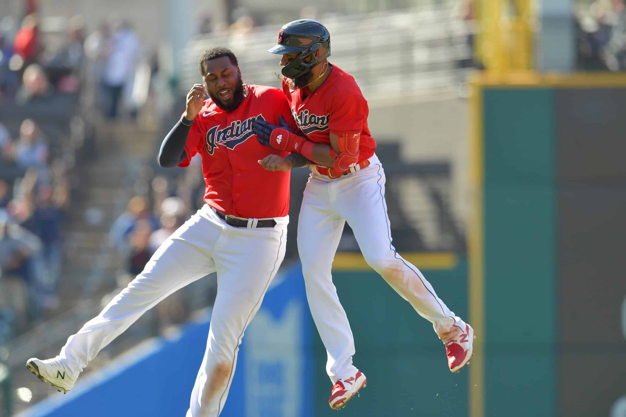 Franmil Reyes #32 celebrates with Amed Rosario #1 of the Cleveland Indians after Rosario hit a walk-off RBI single to defeat the Chicago Cubs at Progressive Field on May 12, 2021 in Cleveland, Ohio. The Indians defeated the Cubs 2-1 in 10 innings.