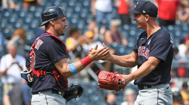 James Karinchak #99 of the Cleveland Indians shakes hands with Ryan Lavarnway #50 after the final out in a 2-1 win over the Pittsburgh Pirates at PNC Park on June 20, 2021 in Pittsburgh, Pennsylvania.