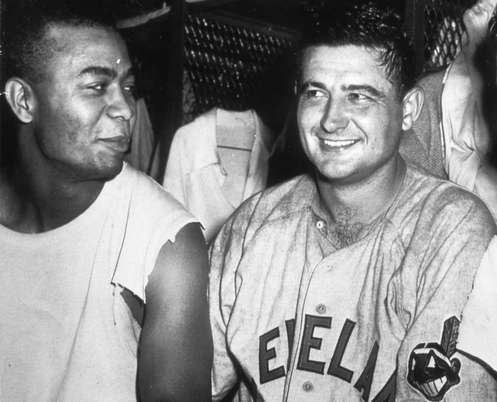 Larry Doby. left, and Early Wynn talk about their performances in the clubhouse after a game in Cleveland, Ohio in 1950.