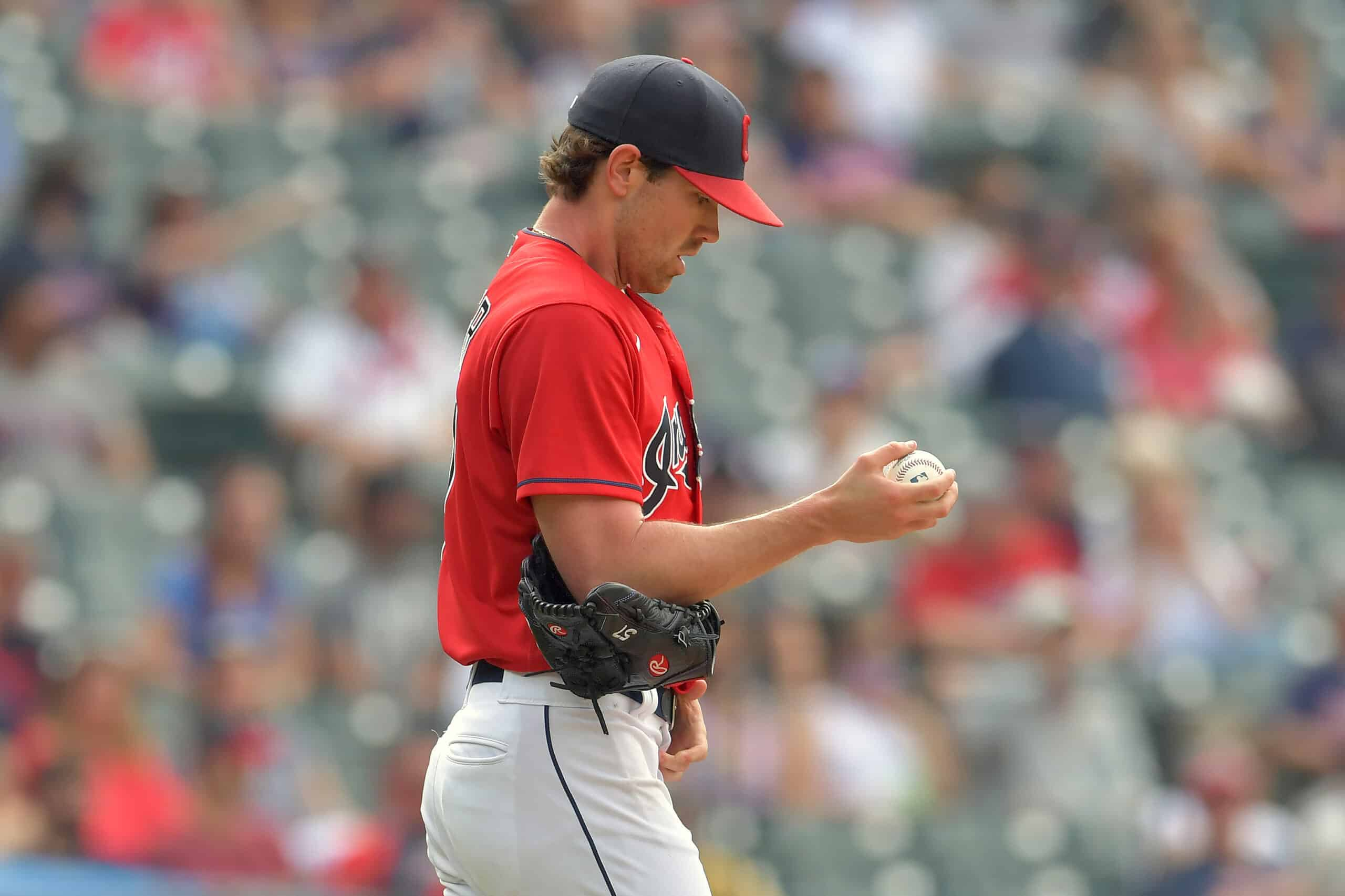 Starting pitcher Shane Bieber #57 of the Cleveland Indians reacts after giving up a solo homer during the fourth inning against the Minnesota Twins at Progressive Field on May 22, 2021 in Cleveland, Ohio.