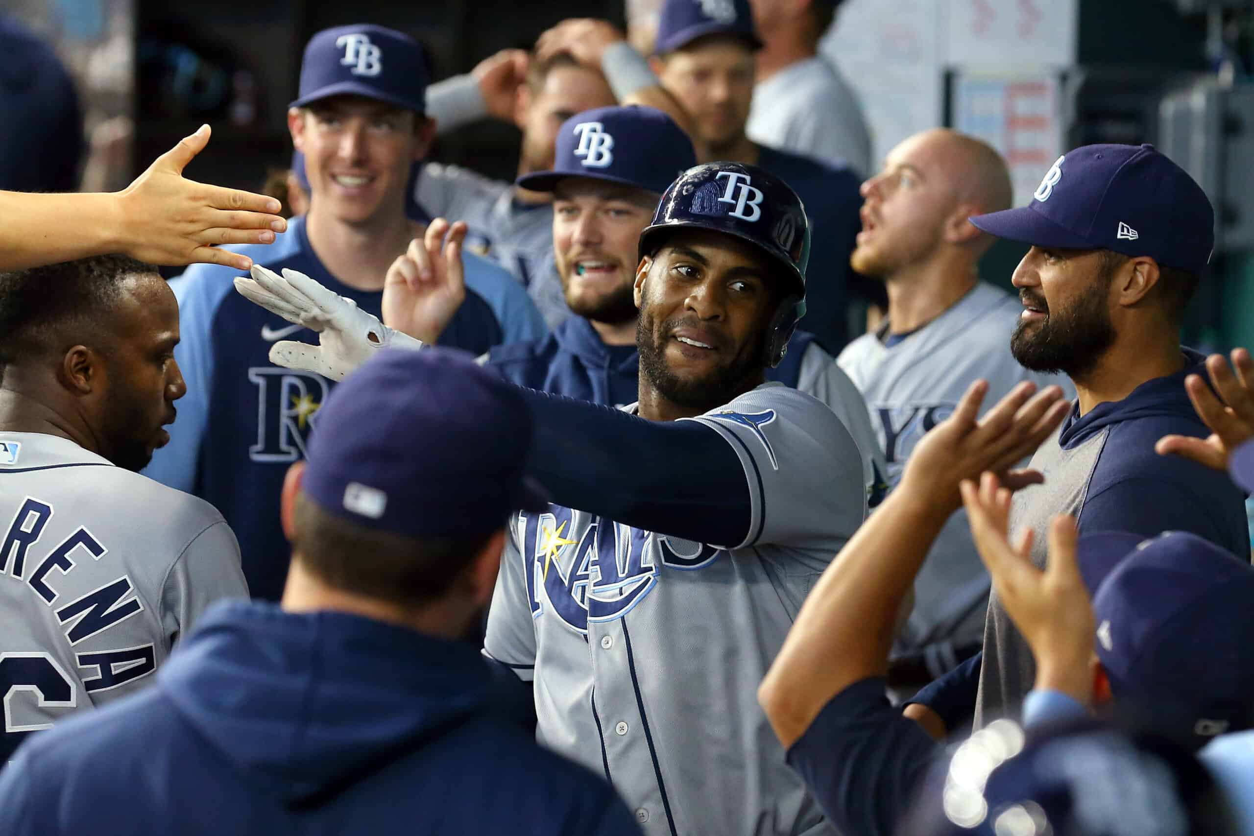 Yandy Diaz #2 of the Tampa Bay Rays is greeted in the dugout after his two-run home run against the Texas Rangers in the ninth inning at Globe Life Field on June 06, 2021 in Arlington, Texas.