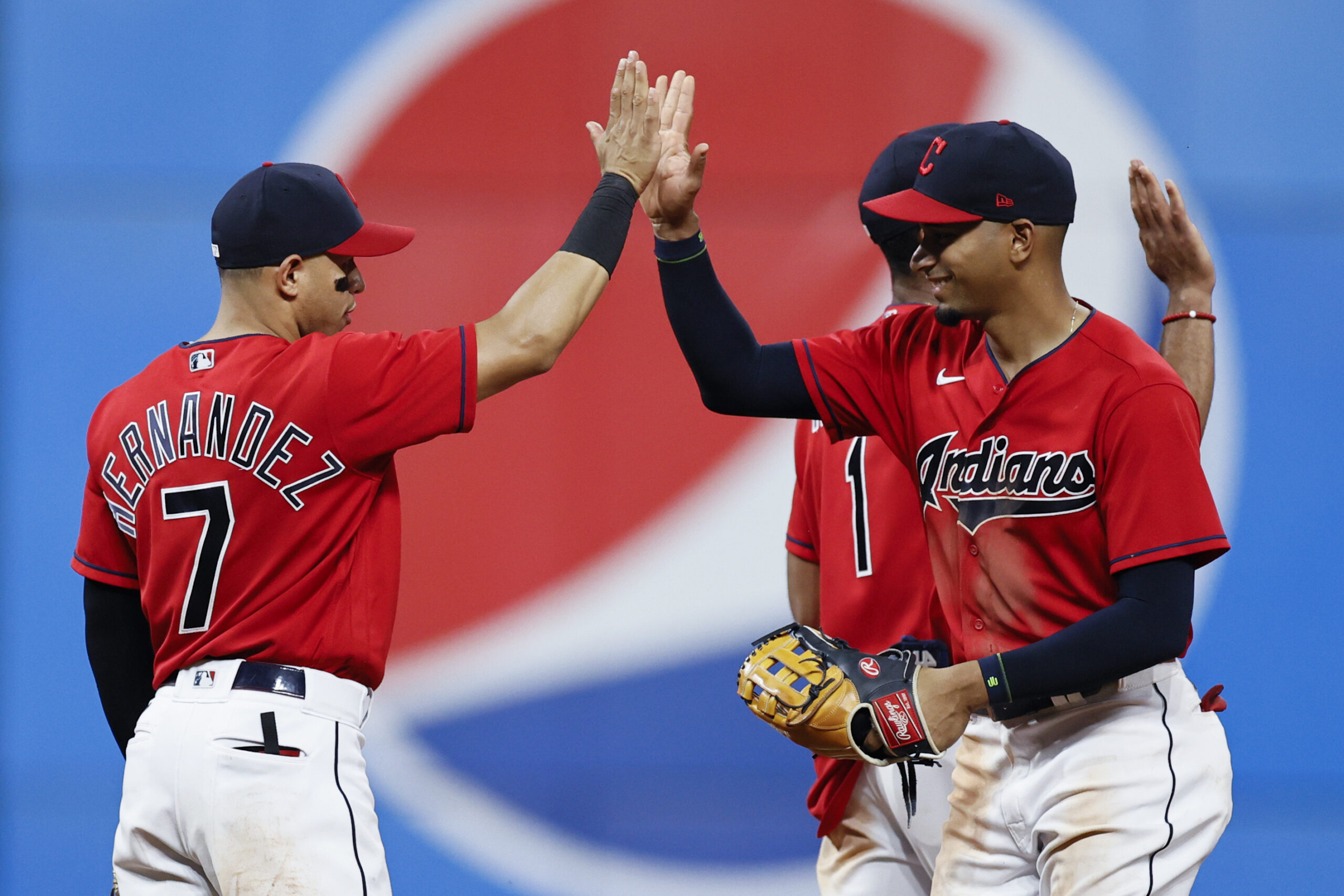 Cesar Hernandez #7 and Oscar Mercado #35 of the Cleveland Indians celebrate a 14-6 victory over the Kansas City Royals at Progressive Field on July 10, 2021 in Cleveland, Ohio.
