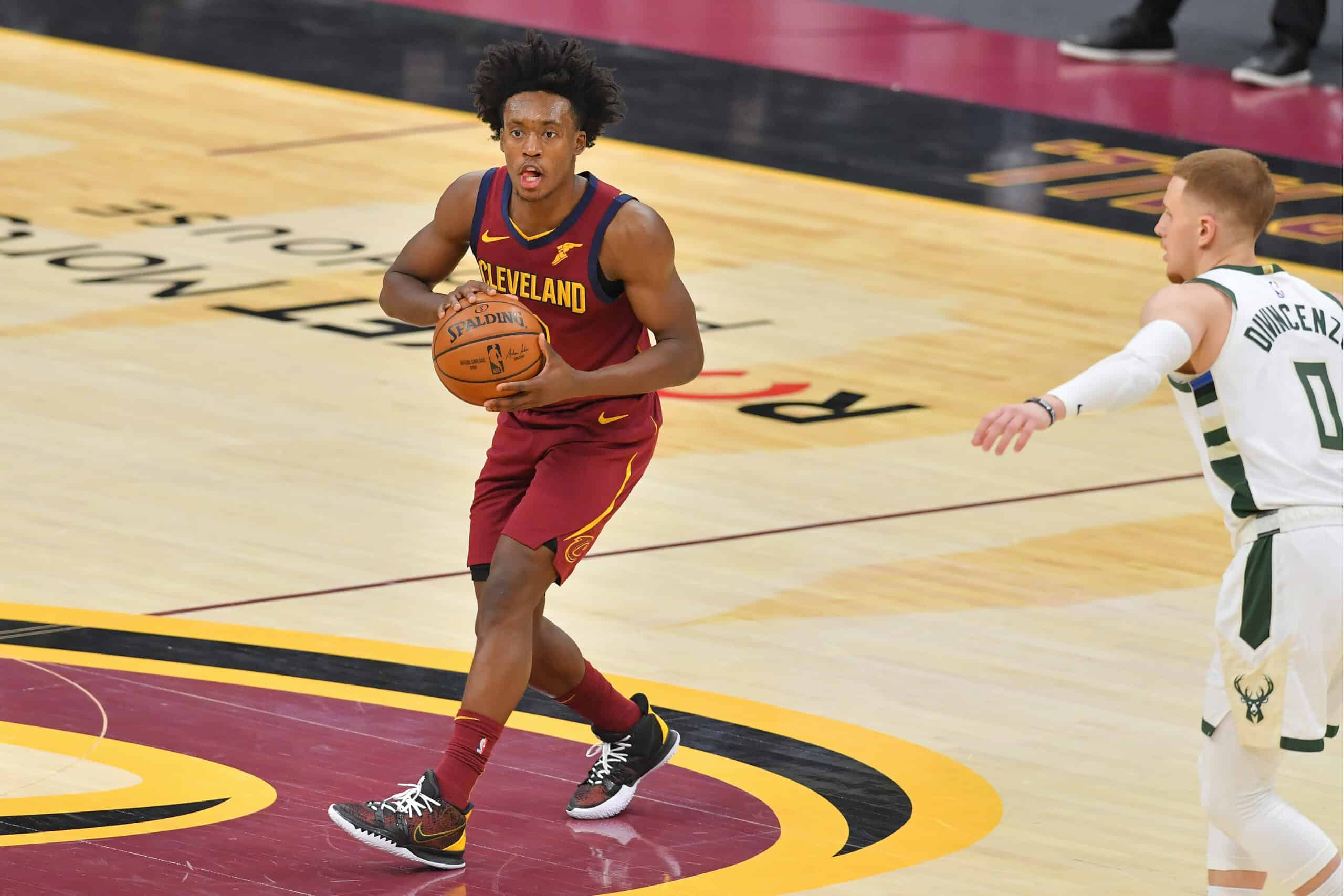 Collin Sexton #2 of the Cleveland Cavaliers passes during the fourth quarter against the Milwaukee Bucks at Rocket Mortgage Fieldhouse on February 05, 2021 in Cleveland, Ohio. The Bucks defeated the Cavaliers 123-105.