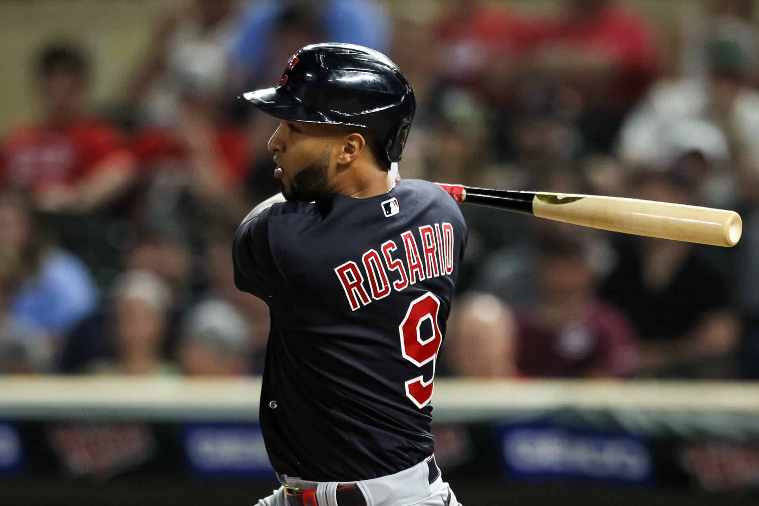 Eddie Rosario #9 of the Cleveland Indians hits a two-run single against the Minnesota Twins in the eighth inning at Target Field on June 24, 2021 in Minneapolis, Minnesota. The Indians defeated the Twins 4-1.