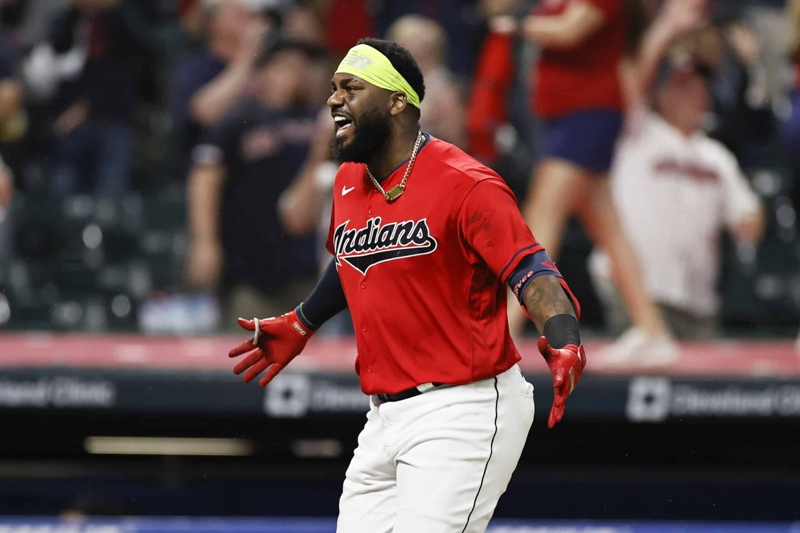 Franmil Reyes #32 of the Cleveland Indians celebrates his game-winning, three-run home run off relief pitcher Greg Holland of the Kansas City Royals in the ninth inning at Progressive Field on July 08, 2021 in Cleveland, Ohio. The Indians won 7-4.
