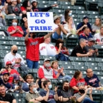 A fan hold up a sign in the third inning during a game between the Cleveland Indians and Detroit Tigers at Progressive Field on April 10, 2021 in Cleveland, Ohio.