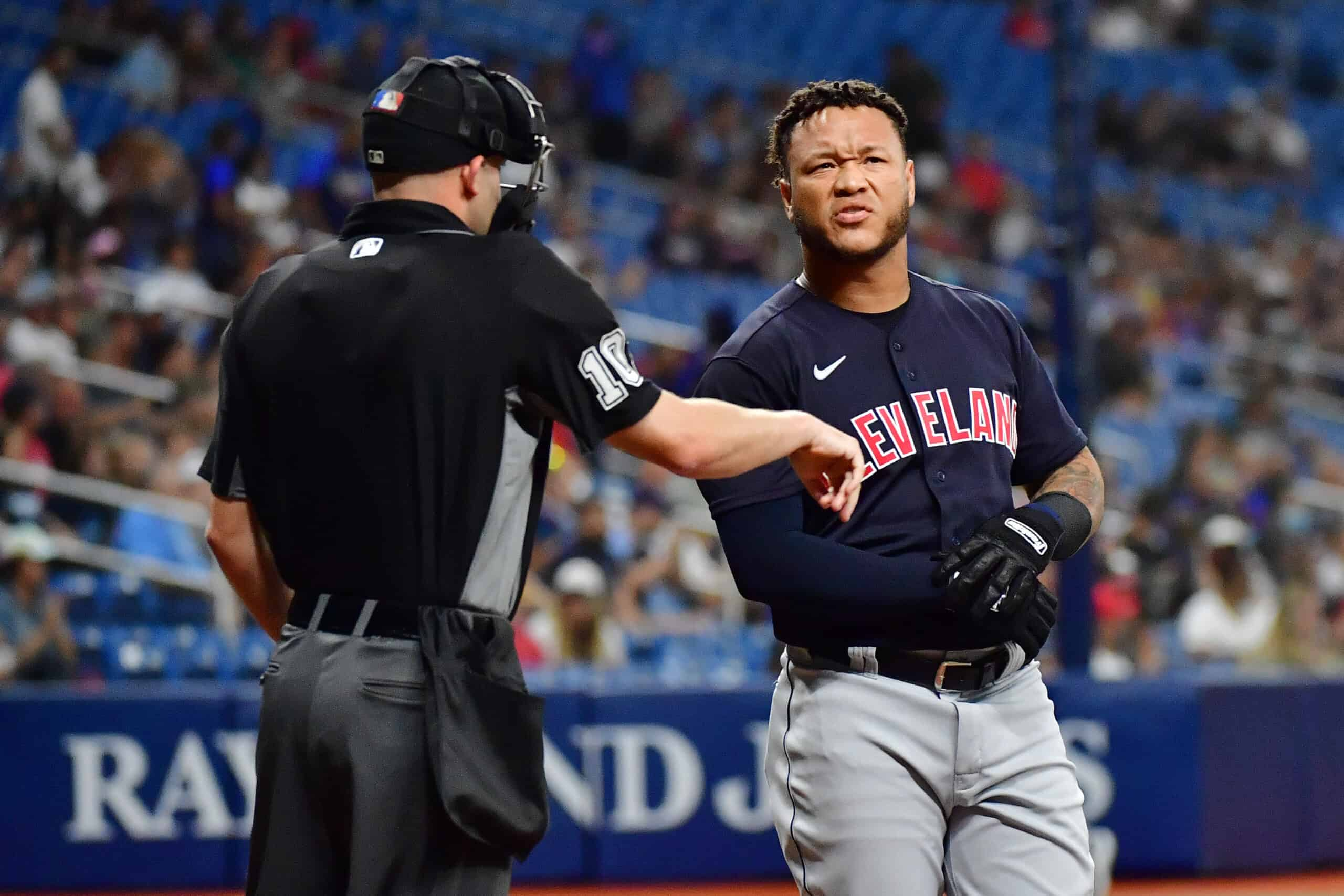 Harold Ramirez #40 of the Cleveland Indians after striking out as umpire Dan Merzelin looks on in the second inning against the Tampa Bay Rays at Tropicana Field on July 05, 2021 in St Petersburg, Florida.
