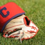 A Cleveland Indians cap and glove are shown on the field before a baseball game against the Baltimore Orioles on May 22, 2014 at Oriole Park at Camden Yards in Baltimore, Maryland.