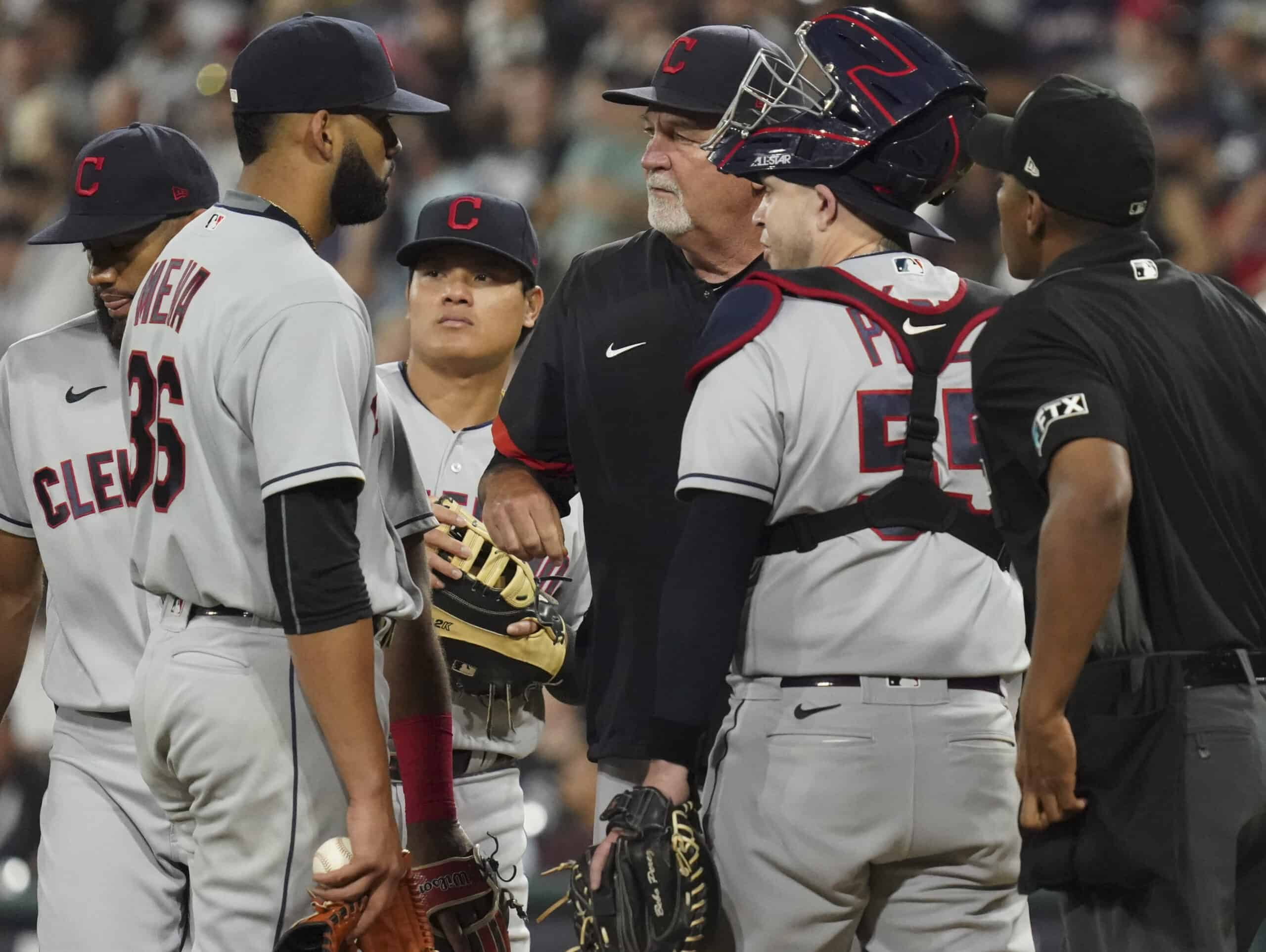 Pitching coach Carl Willis #51 of the Chicago White Sox talks with J.C. Mejia #36 of the Cleveland Indians during the fourth inning of a game against the Chicago White Sox at Guaranteed Rate Field on July 30, 2021 in Chicago, Illinois.