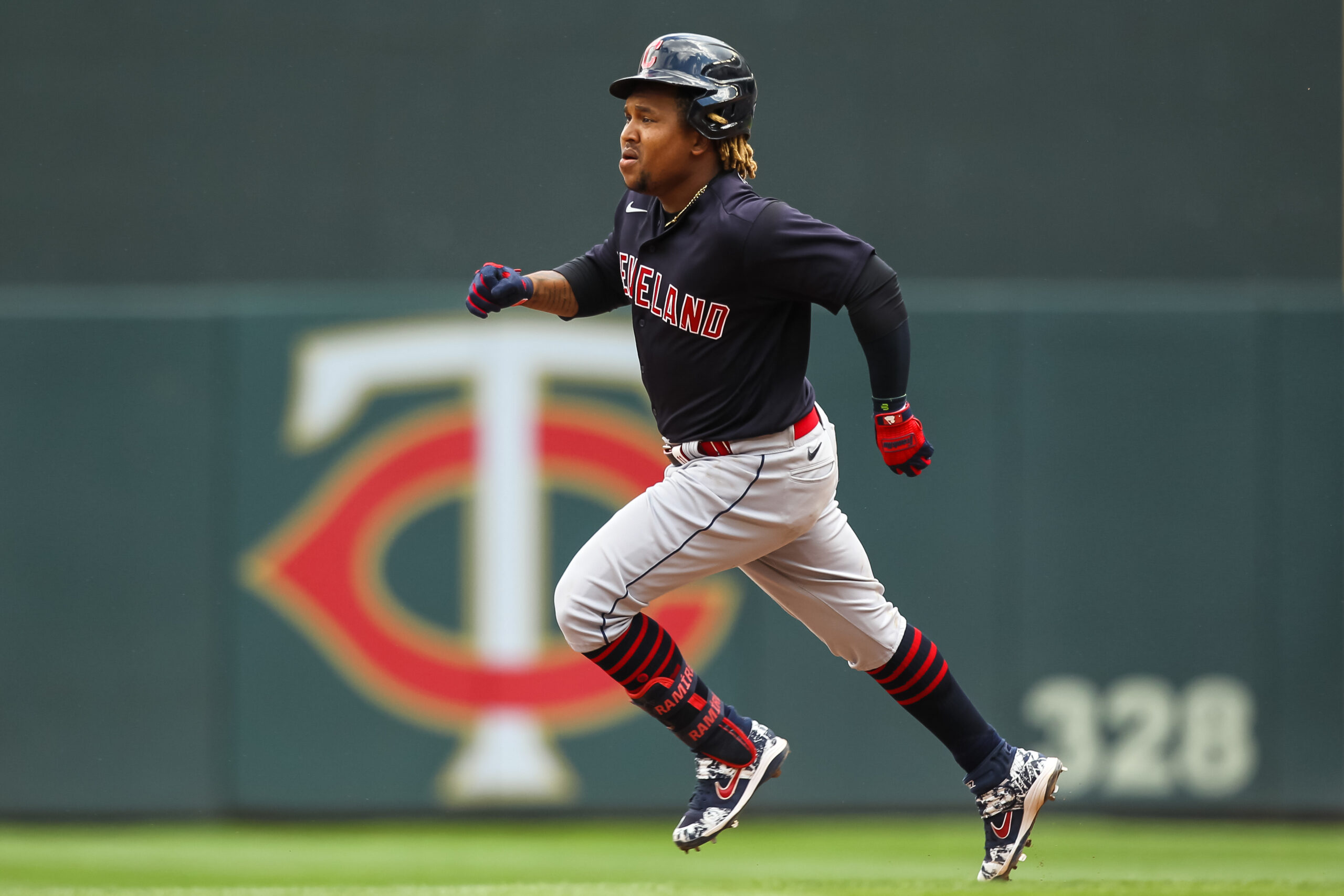 Jose Ramirez #11 of the Cleveland Indians advances to second base after hitting a double against the Minnesota Twins in the sixth inning of the game at Target Field on June 27, 2021 in Minneapolis, Minnesota. The Twins defeated the Indians 8-2.