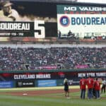 Family members of former Cleveland Indians player'manager Lou Boudreau watch a tribute on the scoreboard before the game against the New York Yankees at Progressive Field on August 5, 2017 in Cleveland, Ohio. The Yankees defeated the Indians 2-1.
