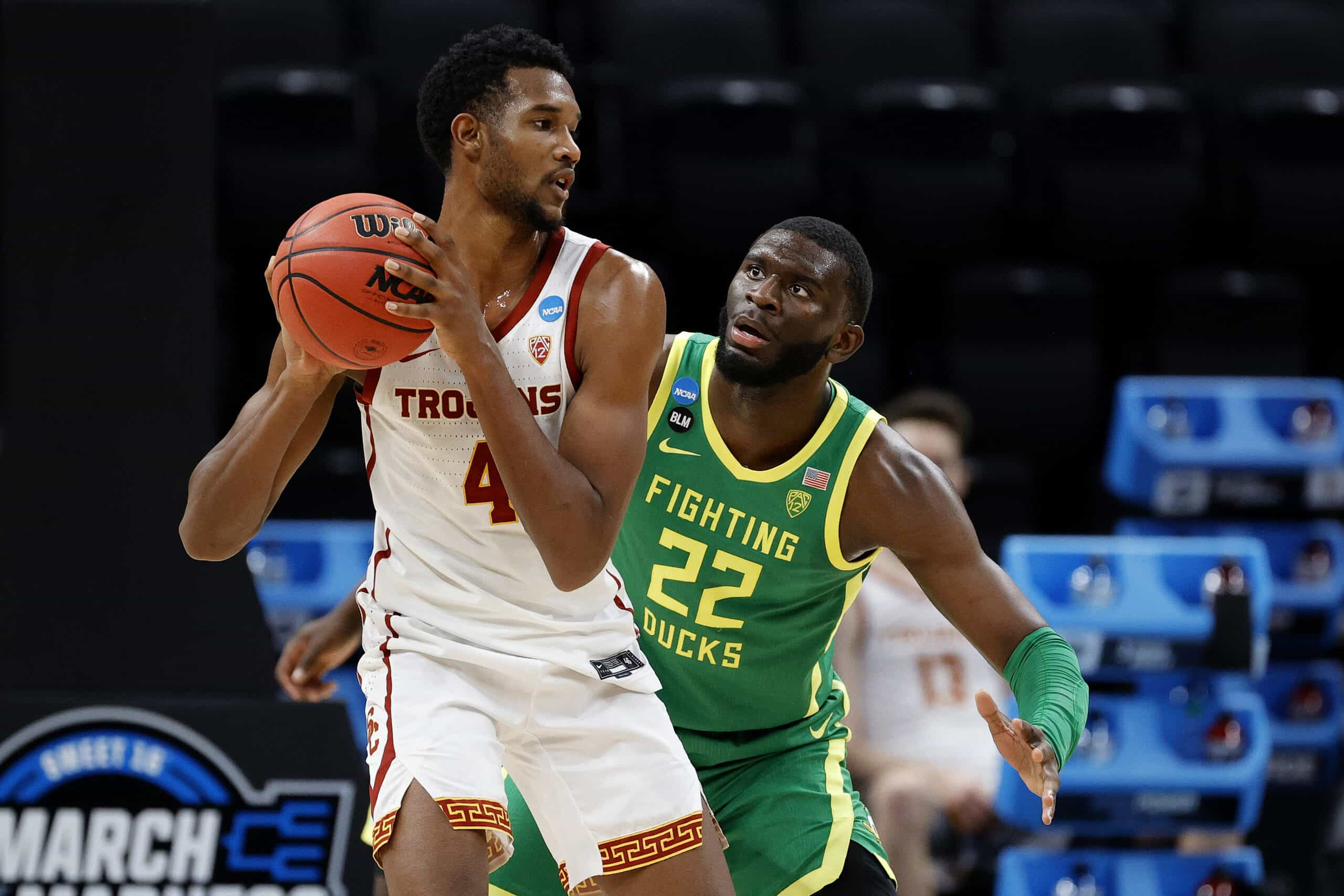 Cavaliers draft target Evan Mobley #4 of the USC Trojans looks to pass against Franck Kepnang #22 of the Oregon Ducks in the second half of their Sweet Sixteen round game of the 2021 NCAA Men's Basketball Tournament at Bankers Life Fieldhouse on March 28, 2021 in Indianapolis, Indiana.