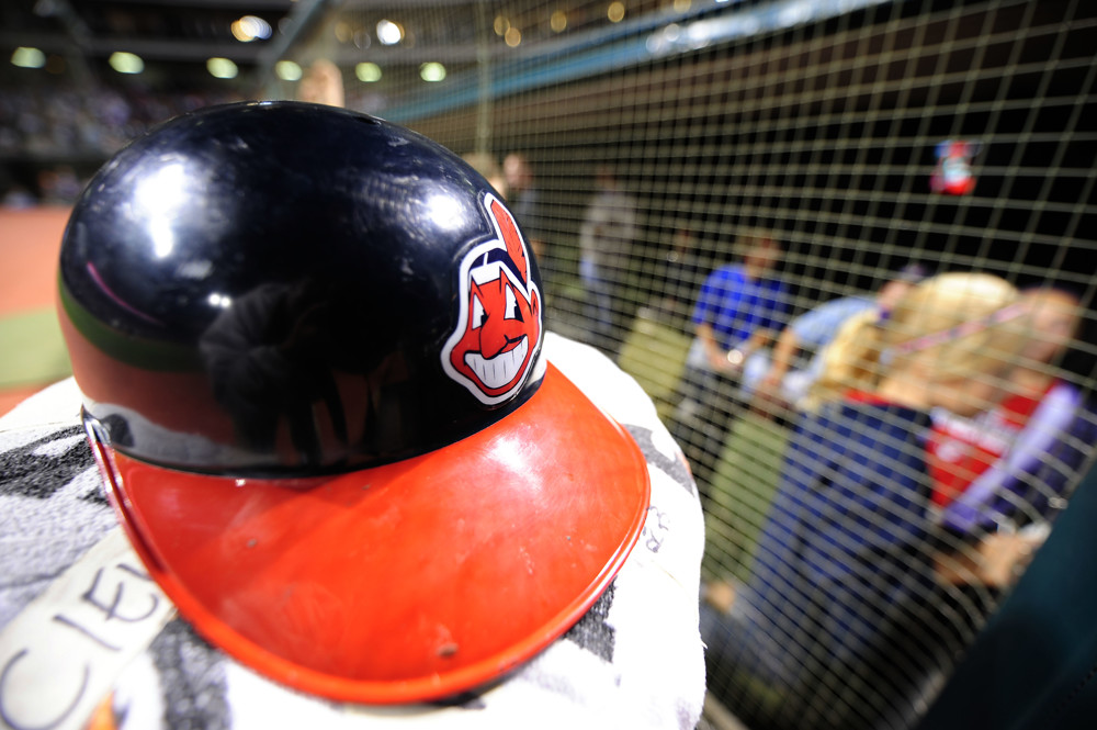 A Cleveland Indians batting helmet rests outside the dugout after a game against the Minnesota Twins at Progressive Field in Cleveland, Ohio. The Indians defeated the Twins 5-2 to take the first game of their three-game weekend series