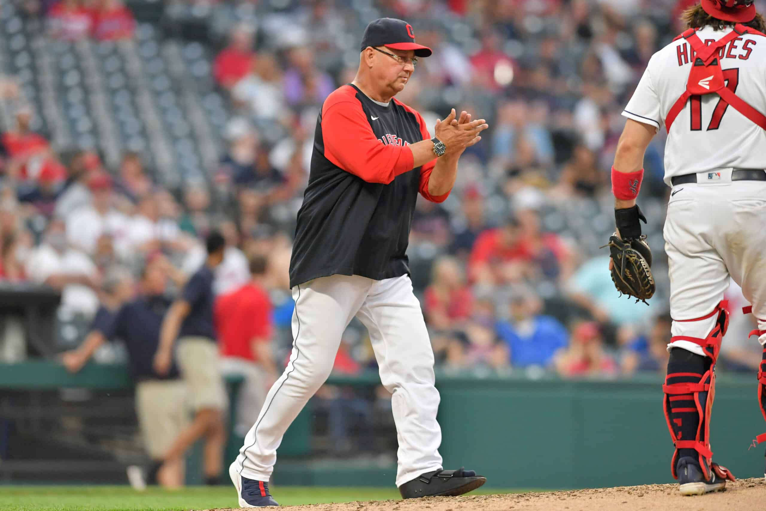 Manager Terry Francona #77 of the Cleveland Indians visits the mound for his second pitching change during the fourth inning against the Minnesota Twins at Progressive Field on May 21, 2021 in Cleveland, Ohio.