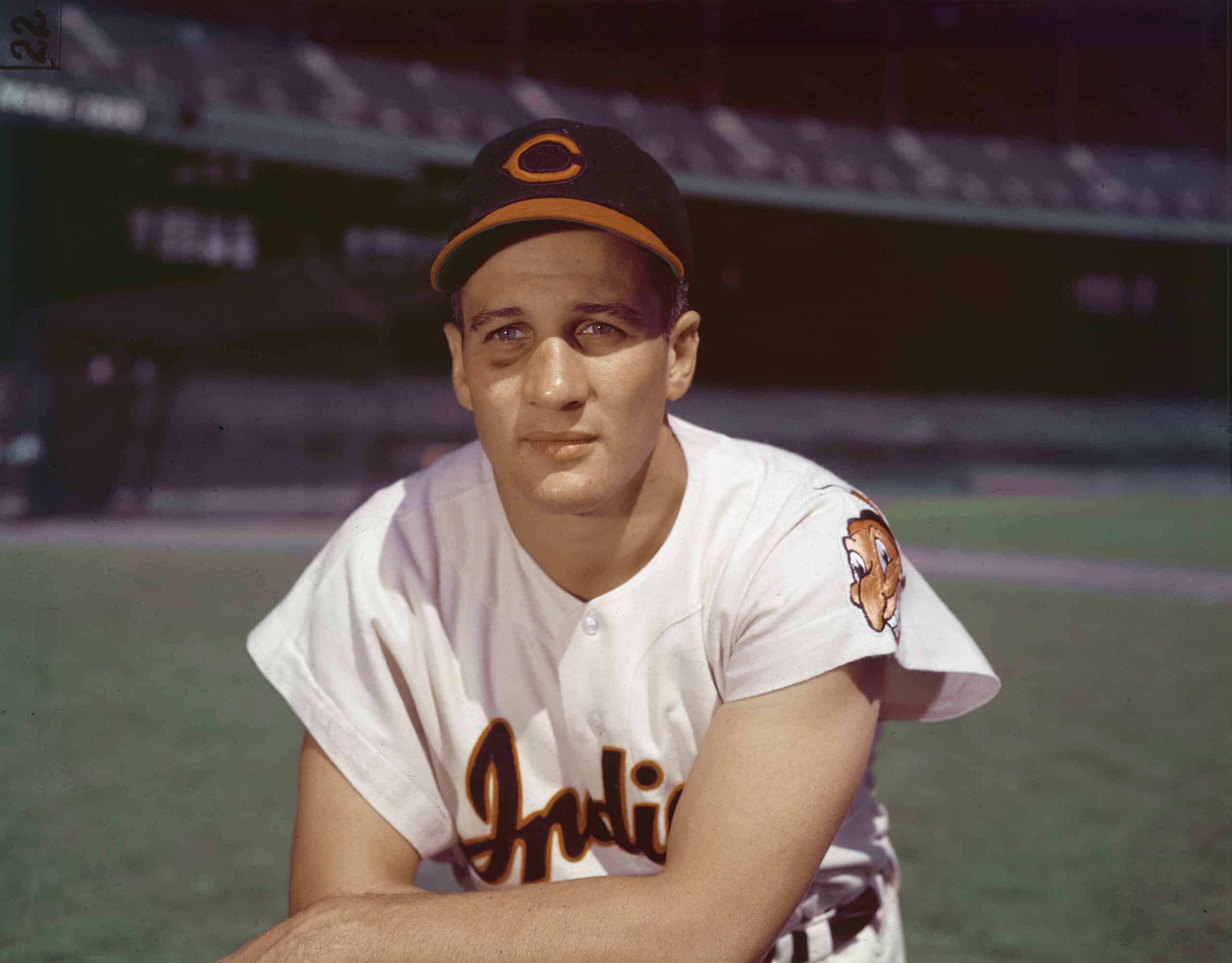 American professional baseball player Al Rosen, third baseman for the Cleveland Indians, kneeling in an empty stadium, 1950s.
