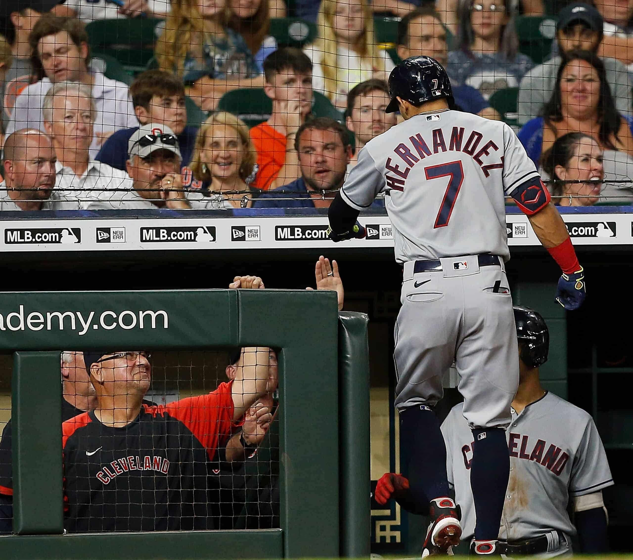 Cesar Hernandez #7 of the Cleveland Indians celebrates in the dugout after hitting a home run in the seventh inning against the Houston Astros at Minute Maid Park on July 21, 2021 in Houston, Texas.